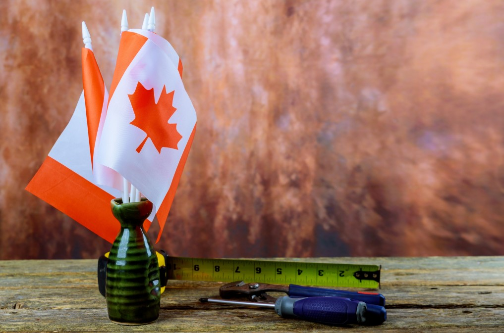 canada-happy-labor-day-hammer-wrench-a-wooden-background-labor-day-concept-canadian-flag_t20_QaZlej