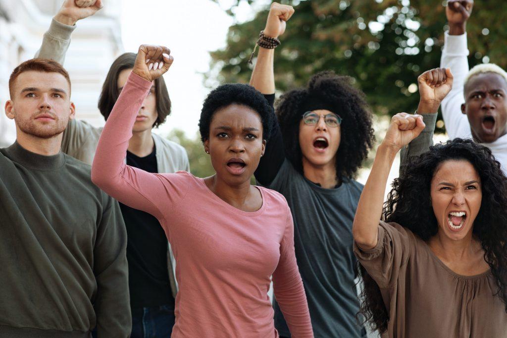 Multiethnic protestors striking against racism on the street