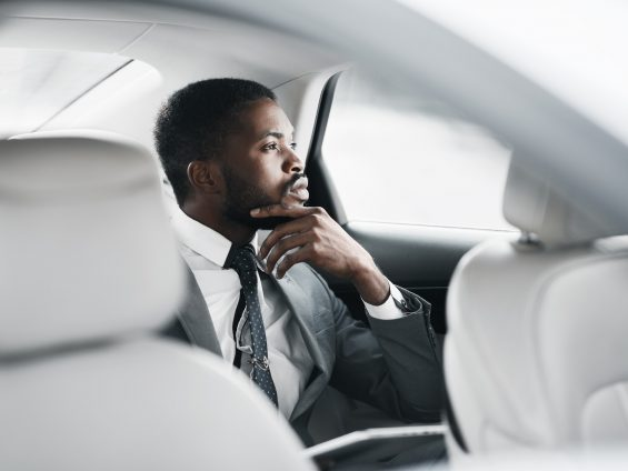 Thinking about solutions. Thoughtful businessman sitting in car