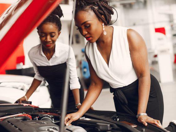 Two stylish black women in a car salon